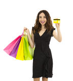Shopping woman showing credit card Stock Images