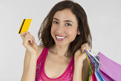 Shopping woman showing credit card Stock Image