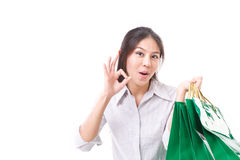 Shopping woman showing ok hand gesture Royalty Free Stock Image