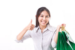 Shopping woman showing thumb up gesture Royalty Free Stock Photos