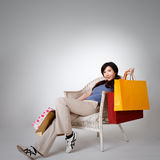 Shopping woman sitting on chair Stock Photography