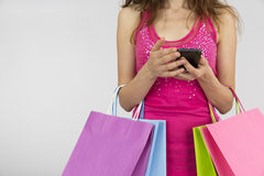 Shopping woman with smart phone Royalty Free Stock Image