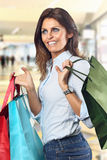 Shopping woman smiles  at department store Stock Images