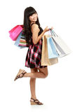 Shopping woman smiling holding shopping bags Stock Photography