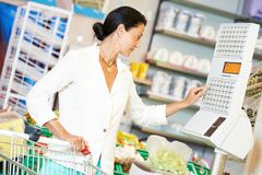 Woman with shopping in supermarket Stock Photo