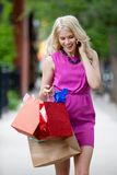 Shopping Woman Talking on Mobile Phone Royalty Free Stock Photos