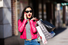 Shopping woman talking on mobile phone Stock Images
