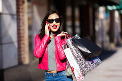 Shopping woman talking on mobile phone Stock Image