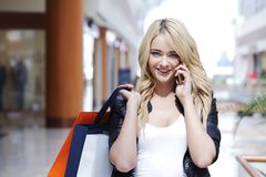 Shopping woman talking on the phone Stock Photography