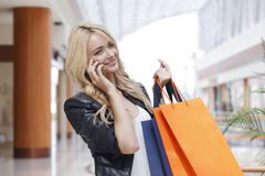 Shopping woman talking on the phone Stock Image