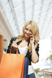Shopping woman talking on the phone Royalty Free Stock Image