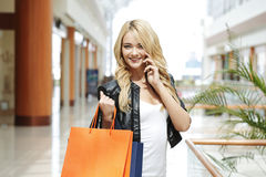 Shopping woman talking on the phone Royalty Free Stock Photo
