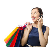 Shopping woman talking on the phone. Shopping woman holding shopping bags and talking on the phone Royalty Free Stock Photography
