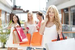 Shopping woman talking on the phone royalty free stock photos