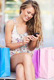 Shopping woman text messaging Stock Photography