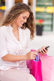 Shopping woman text messaging Stock Image