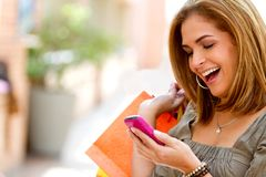 Shopping woman texting Royalty Free Stock Photos