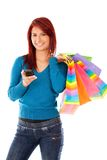 Shopping woman texting Stock Photography