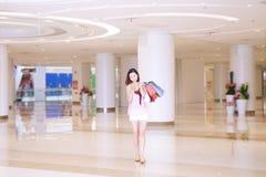 Shopping woman texting Royalty Free Stock Photo