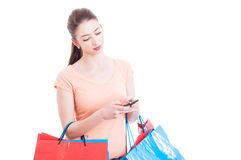 Shopping woman texting or checking online banking Stock Photos