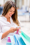 Shopping woman texting Stock Photo