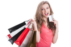 Shopping woman thinking while holding a card Royalty Free Stock Images