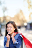 Shopping woman thinking looking up outdoors Stock Photos