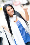 Shopping woman with thumbs up Royalty Free Stock Photography