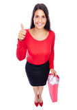 Shopping woman thumbs up. Business Woman looking Cute Into Camera showing thumbs up Isolated on White Royalty Free Stock Images