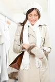 Shopping woman trying winter gloves Royalty Free Stock Image