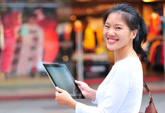 Shopping woman use tablet Stock Image