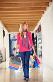 Shopping woman walking Royalty Free Stock Image