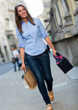 Shopping woman walking with bags Stock Image