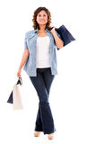 Shopping woman walking with bags Stock Images