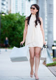 Shopping woman walking outdoors Stock Images