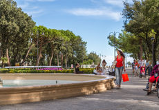 Shopping woman walking though avenues. Attractive mature woman walks through the avenues of Rimini while doing shopping Stock Images