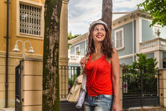 Shopping woman walking though avenues. Attractive mature woman walks through the avenues of Rimini while doing shopping Royalty Free Stock Photography