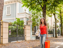 Shopping woman walking though avenues. Attractive mature woman walks through the avenues of Rimini while doing shopping Stock Photos