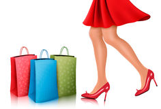 Shopping woman wearing red dress and high heel shoes with shoppi Royalty Free Stock Photos