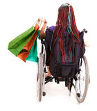 Shopping woman on wheelchair. White background Royalty Free Stock Images