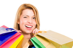 Shopping woman winking Stock Image