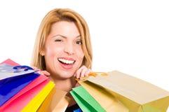 Shopping woman winking Stock Image