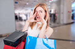 Shopping woman yelling and holding shopping bags Royalty Free Stock Photo