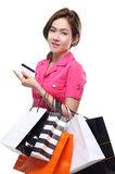 Shopping women asian happy smiling holding shopping bags by credit card isolated on white background Stock Image