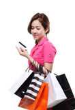 Shopping women asian happy smiling holding shopping bags by credit card isolated on white background Stock Images