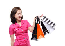 Shopping women asian happy smiling holding shopping bags by credit card isolated on white background Royalty Free Stock Image