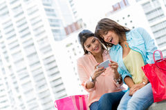 Shopping women with a cell phone Royalty Free Stock Photo