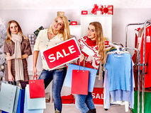 Shopping women at Christmas sales. Stock Photo