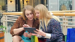 Shopping Women with Digital Tablet bench on the stock video