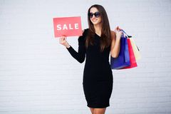 Shopping. Women holdingdiscount blanks on ligth background in black friday holiday.  royalty free stock images